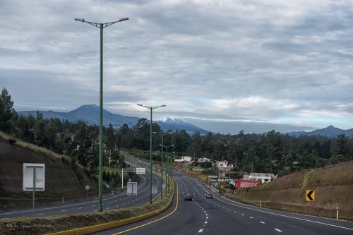 Leaving Quito with Antisana and Cotopaxi in the distance mgp 12