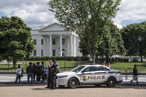 white house with police car